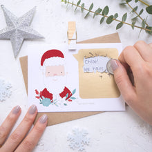 Load image into Gallery viewer, Personalised Santa secret message Christmas scratch card being scratched off with a coin.