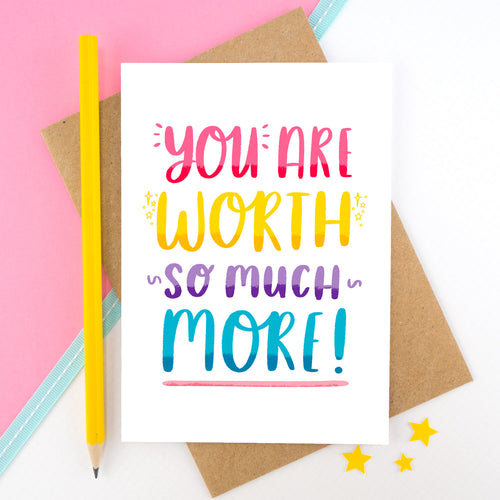 A hand lettered card featuring rainbow hand lettering with the phrase 'you are worth so much more'.