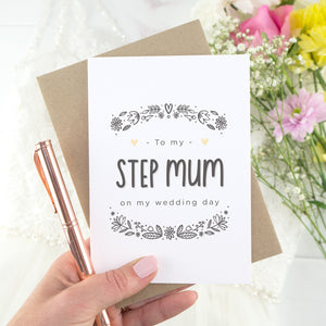 To my step mum on my wedding day. A white card with grey hand drawn lettering, and a grey floral border. The image features a wedding dress and bouquet of flowers.