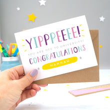 'Yipppeeee! You are off to university, congratulations! A personalised university exams congratulation card with alternative shades of blue, purple and pink, over a hand lettered font, small grey stars and a yellow name box.