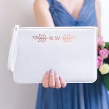 Load image into Gallery viewer, A white, personalised Bridesmaids wristlet held by Joanne Hawker in a lilac bridesmaid dress with a bunch of pink and red roses.
