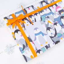 A close up of the penguin gift wrap and matching gift tag.