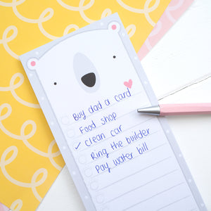 Polar bear to do list, shopping list notepad in use