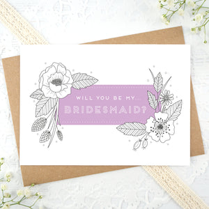A floral outline, will you be my bridesmaid card in purple