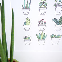 Load image into Gallery viewer, A close up of the Succulent cacti plant with smiling faces on the pots