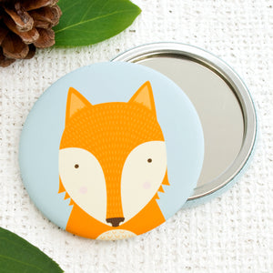 A friendly orange fox pocket mirror.