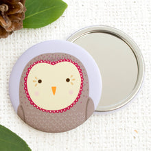 An illustrated Owl Pocket mirror.