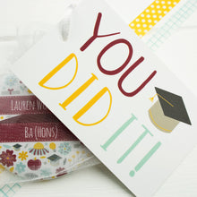 Each graduation pocket mirror comes with a gift tag that says 'you did it!'