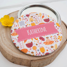 A personalised bees and flowers pocket mirror featuring bumble bees, hives and plenty of florals in a pink colour palette