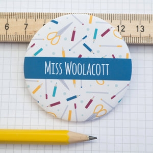 A personalised pocket mirror with pens, pencils and polka dots