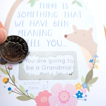 A baby announcement scratch card. New baby. You're going to be grandparents.
