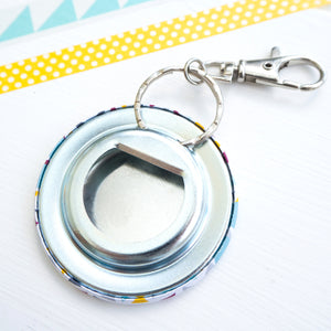 The back of the personalised graduation bottle opener key ring with a geometric pattern and space for a name and degree classification