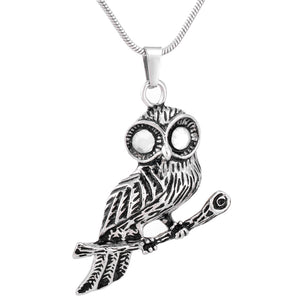 Standing in the branches of the OWL Stainless Steel Cremated Remains Jewelry