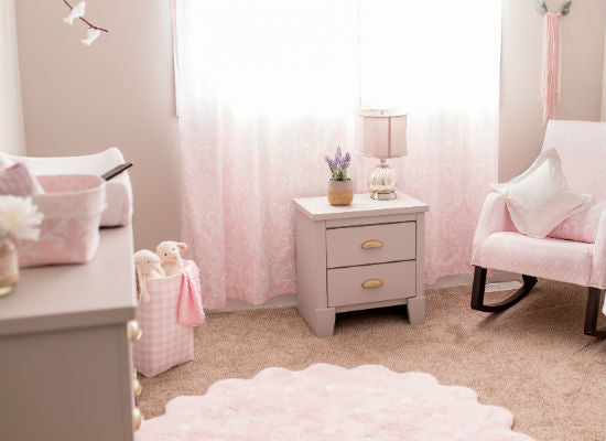 soft pink rug in a baby girl's nursery room