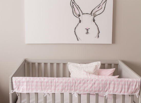 bunny painted on canvas above baby crib in nursery