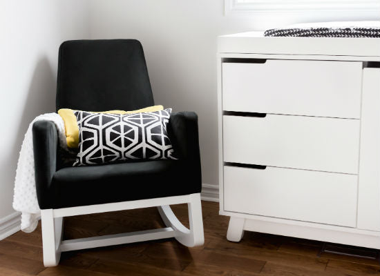 black and white nursery chair with giraffe print lumbar pillow