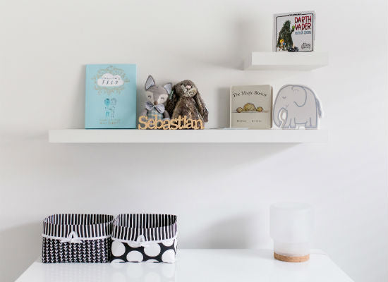 white book shelves above change table for books and small keepsacks