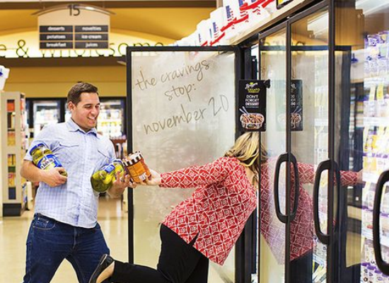 couple in grocery store freezer section