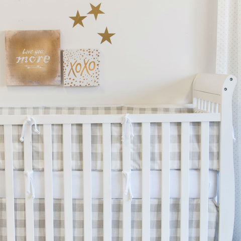 neutral soft grey plaid crib bumper pads with gold stars and XOXO art