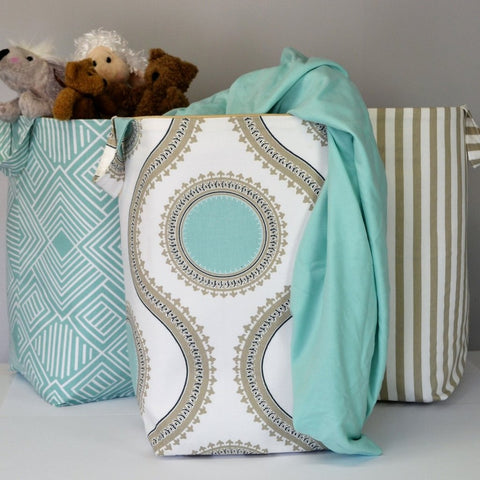 teal maze hamper and white and tan with teal circle hamper