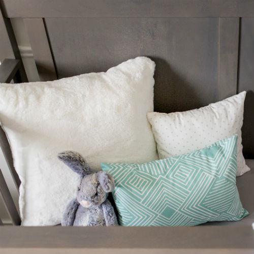 teal maze pillow with 2 white pillows in a set