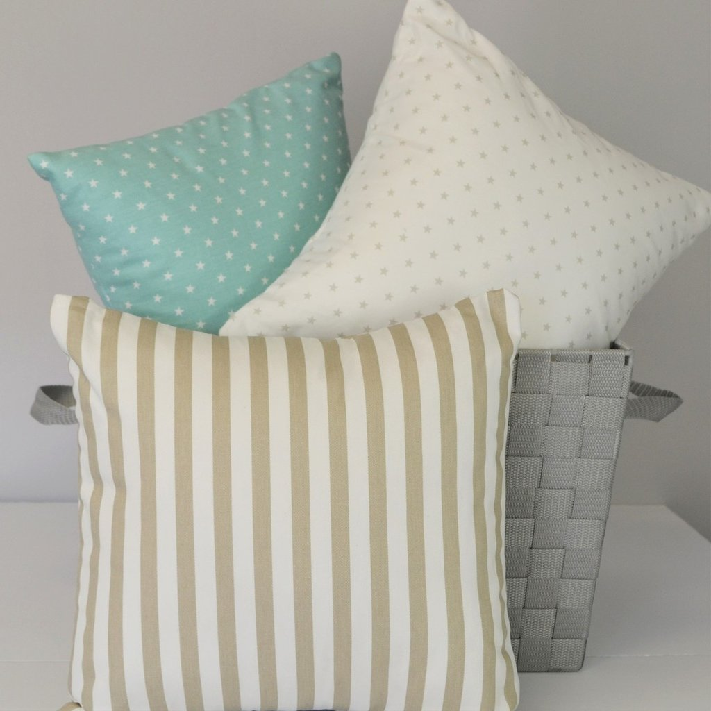 one teal one white and one tan aquila  pillow set