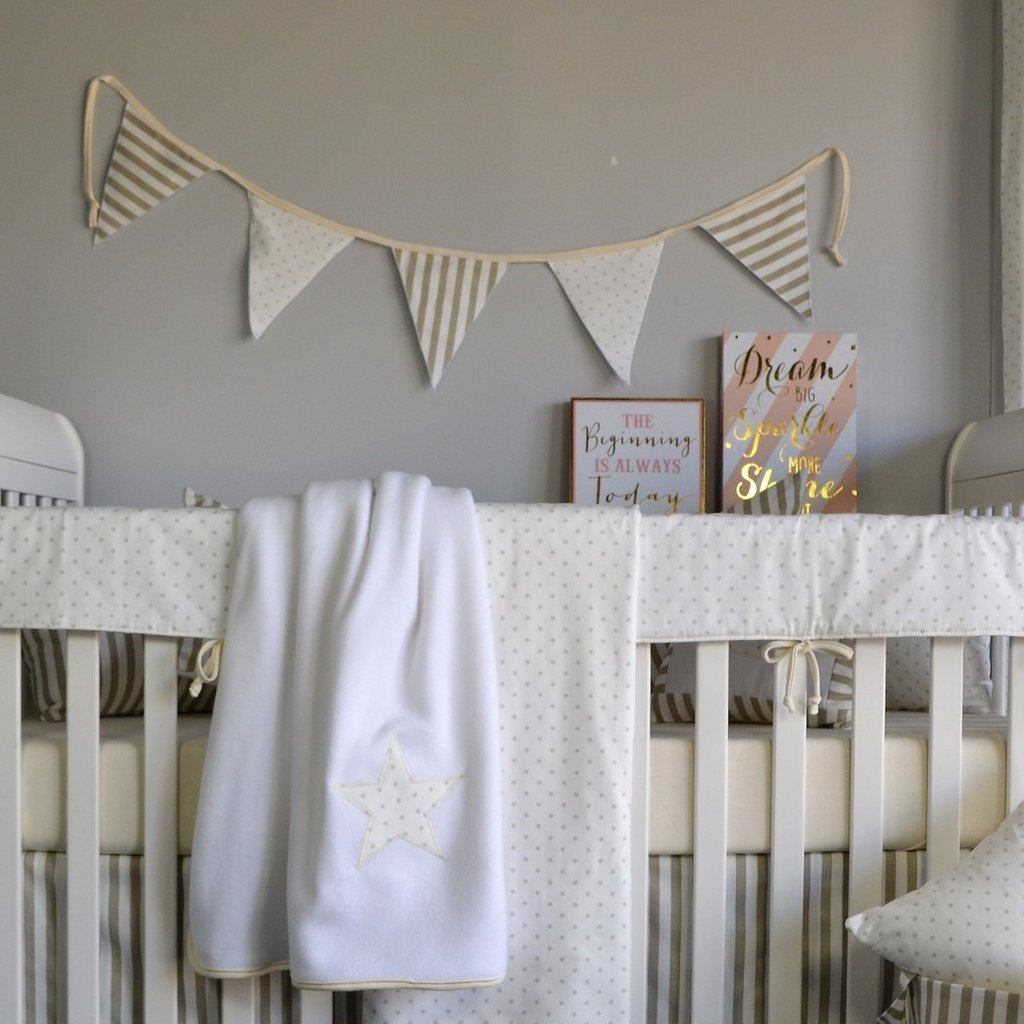 white crib set with aquila varsity flag hanging on wall
