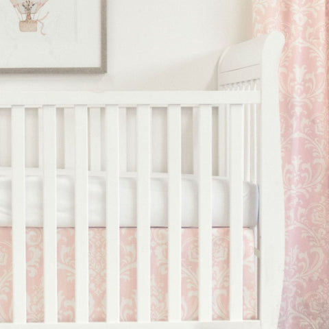 white crib with pink and white scroll crib skirt and drapes, and white forever crib sheet