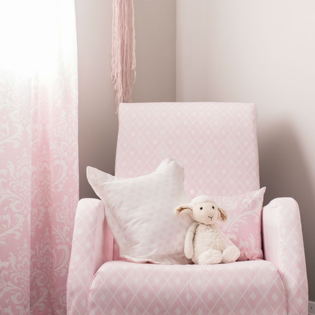 pink and white decor flange pillow on chair with lamb and drapes