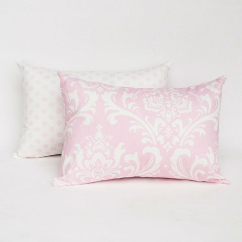 pink and white lumbar pillows