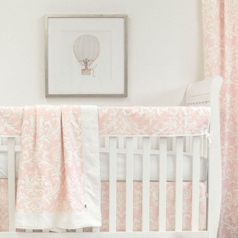 white crib with pink and white scroll crib skirt and drapes, rail protector, and white forever crib sheet