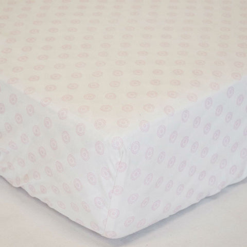 pink and white pinwheel woven crib sheet
