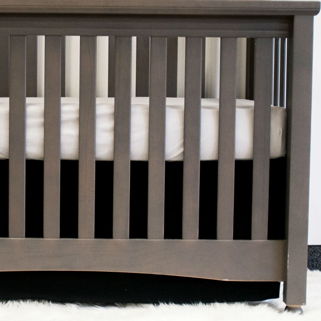black crib skirt on grey crib with grey sheet