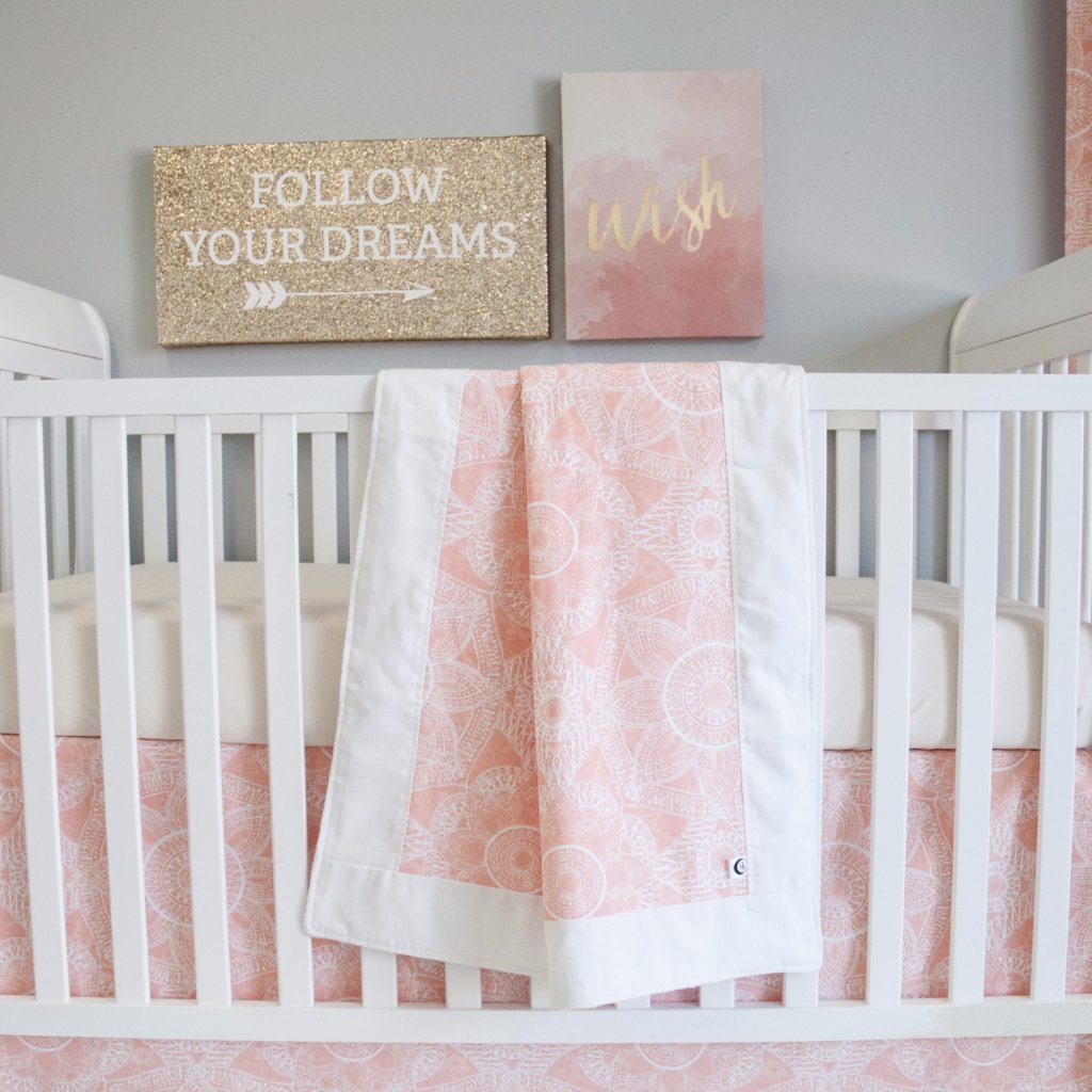 blush pink crib set with blanket crib skirt sheet on white crib