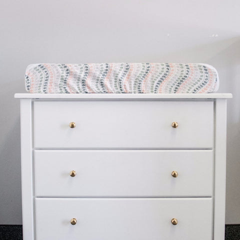 jewel dot change pad cover on white dresser with gold handles