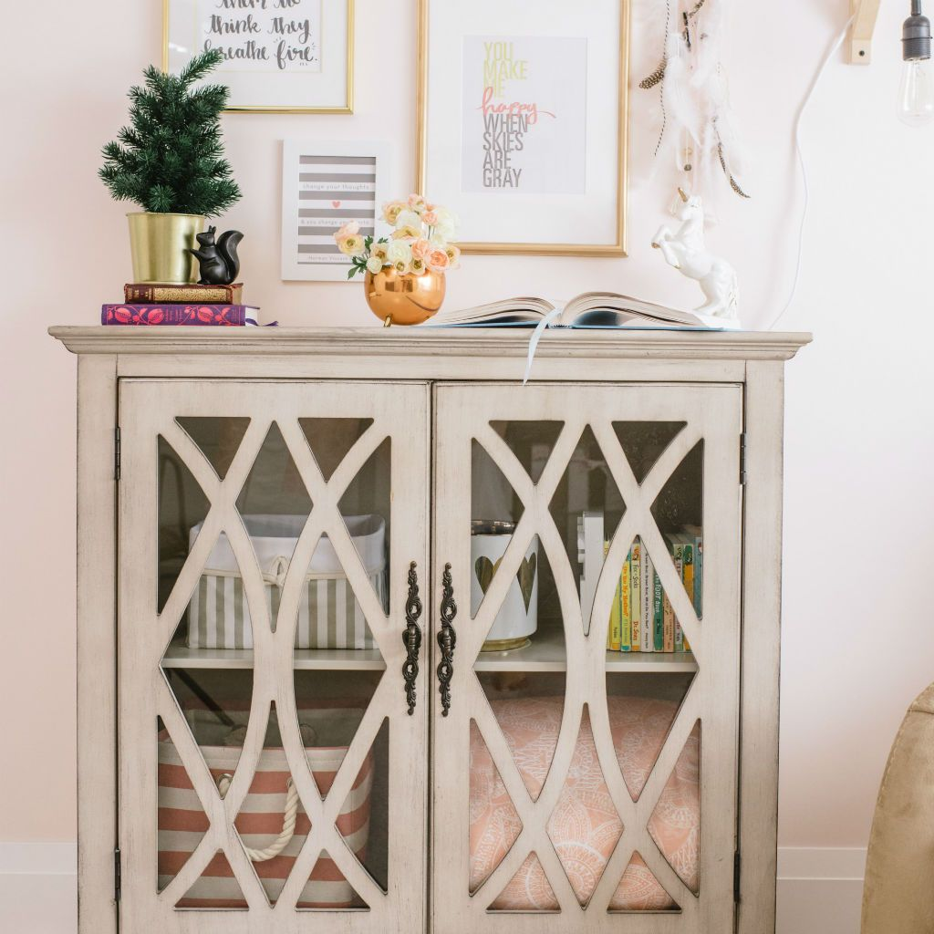 blush pink basket and play blanket in soft grey ornate cabinet