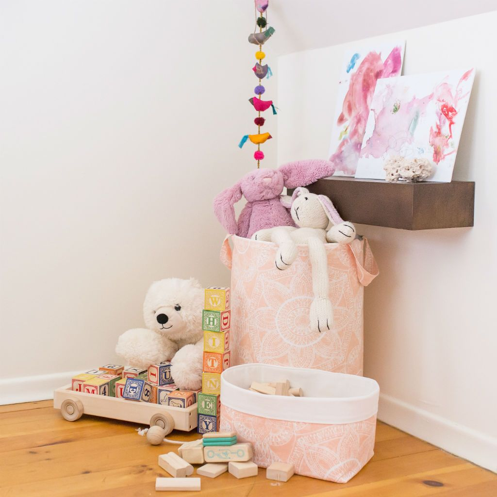 blush pink soft nursery hamper and basket in reading nook