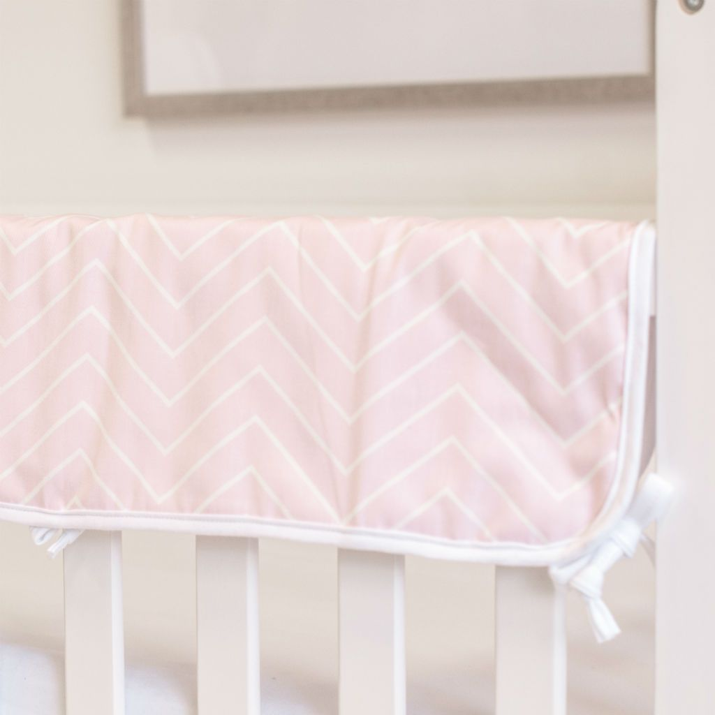 closeup of a light pink and white chevron rail protector