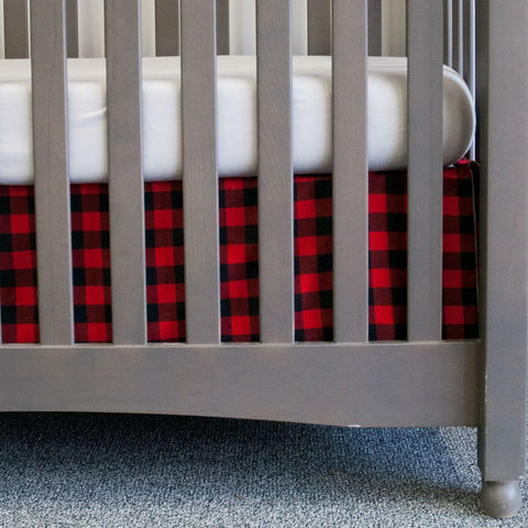 black and red crib skirt with grey crib sheet on grey crib