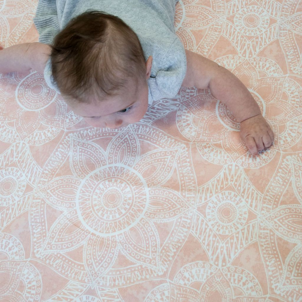 cute baby on blush pink play blanket
