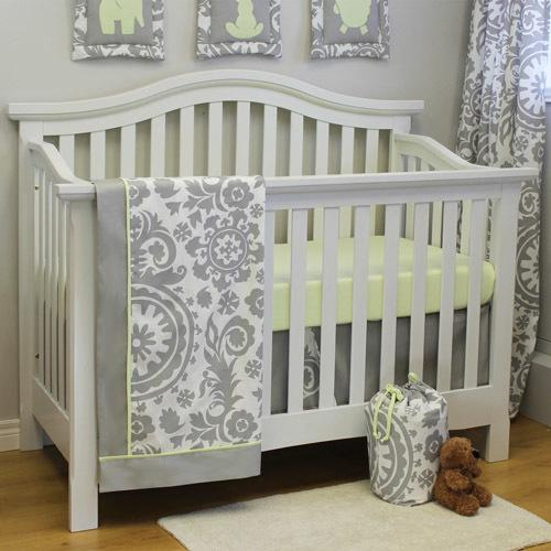 grey and white floral crib set with blanket, crib skirt, sheet on white crib