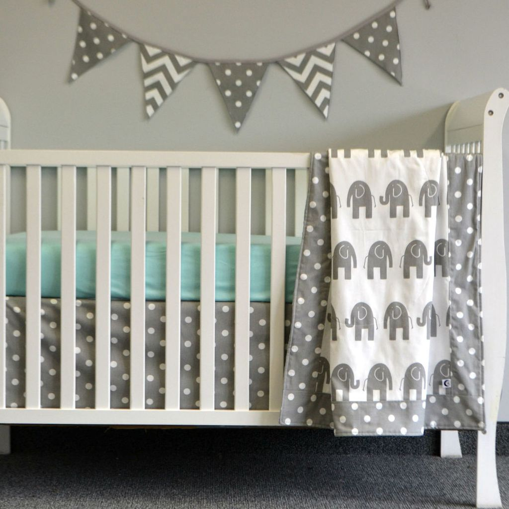 elephant baby crib set in grey and white on white crib with varsity flag wall art