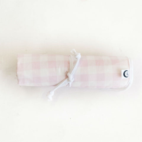 pink and white plaid baby changing travel mat