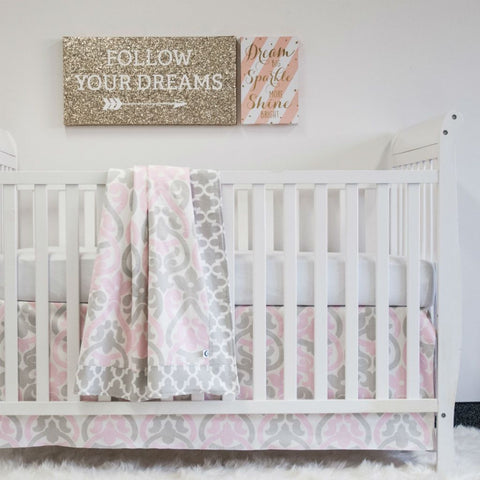 white crib with pink and grey floral scroll and grey trellis blanket, and crib skirt, and follow your heart artwork