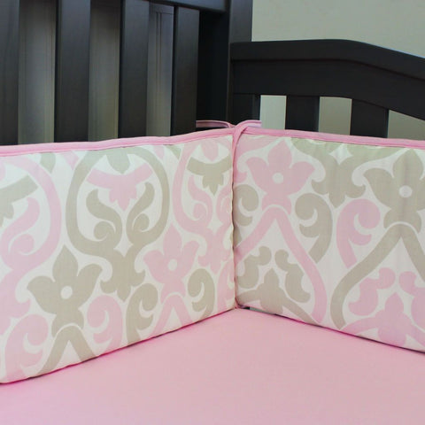 grey crib with pink and grey floral scroll bumper pads