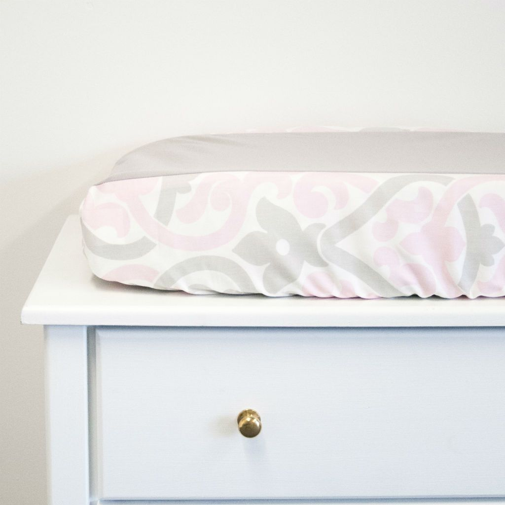 white dresser with pink and grey floral scroll and grey knit centre