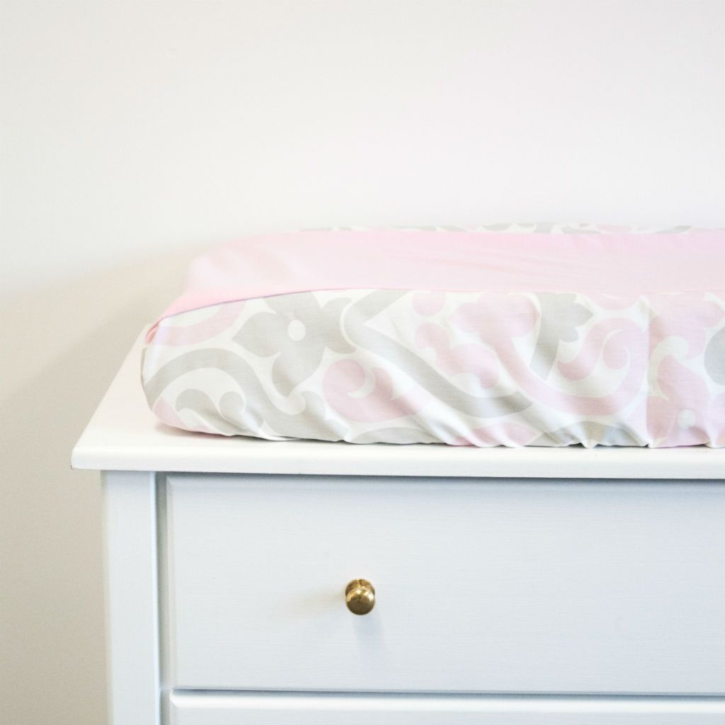 white dresser with pink and grey floral scroll and pink knit centre