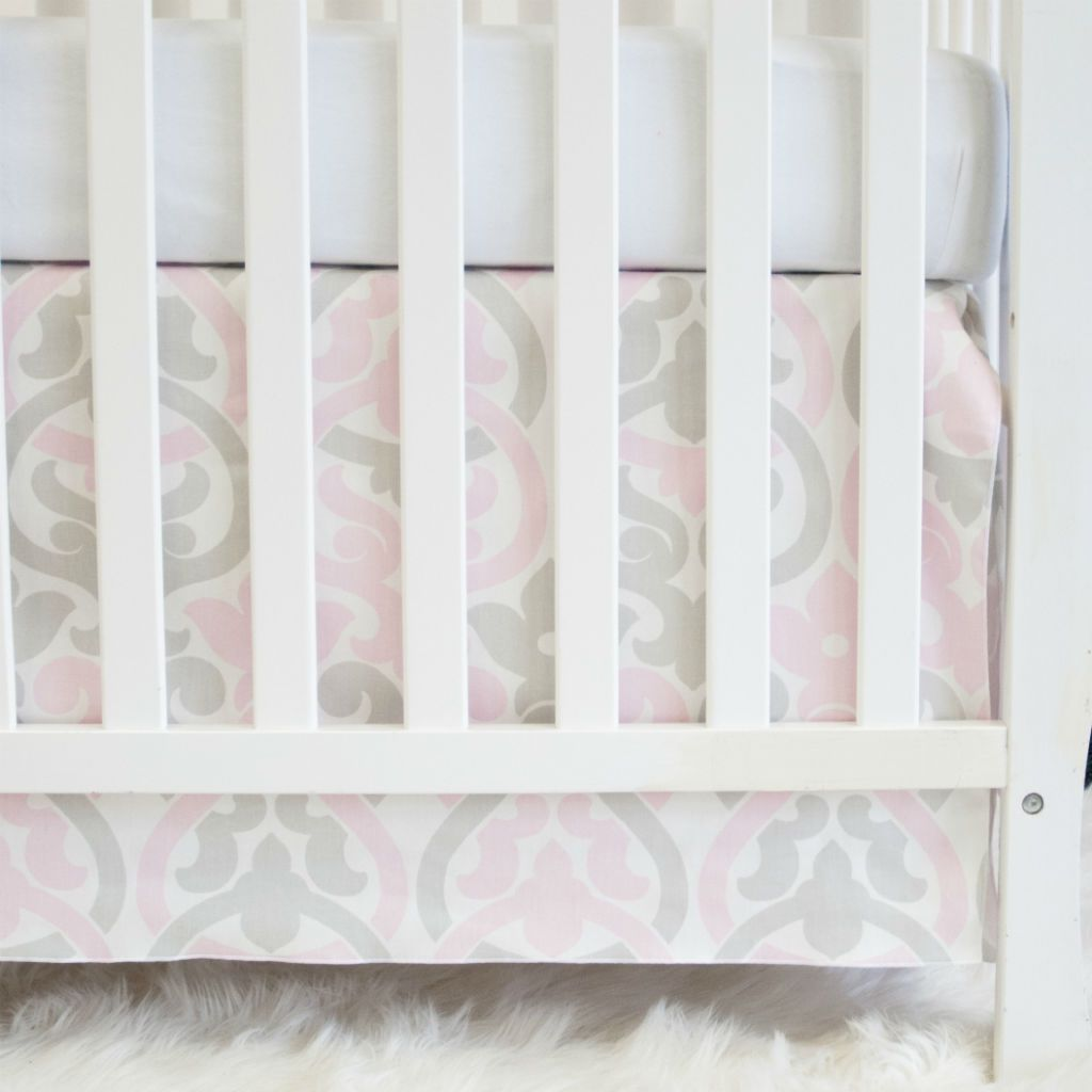 white crib with pink and grey floral scroll crib skirt and forever white crib sheet