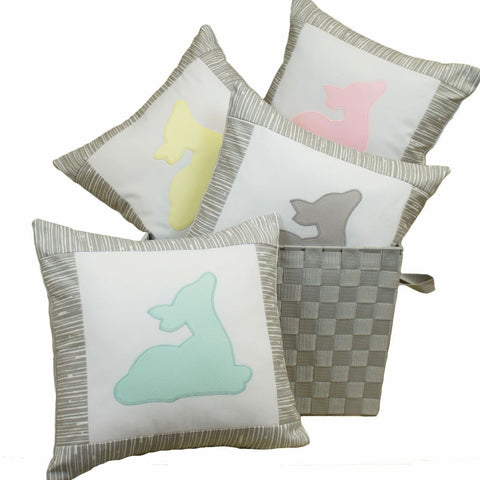 colored pillows with deer on them