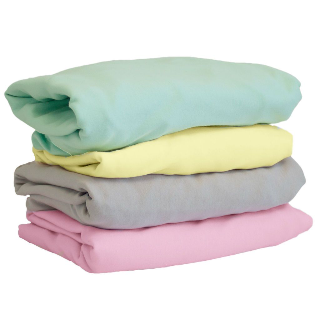 stacked colored crib sheets